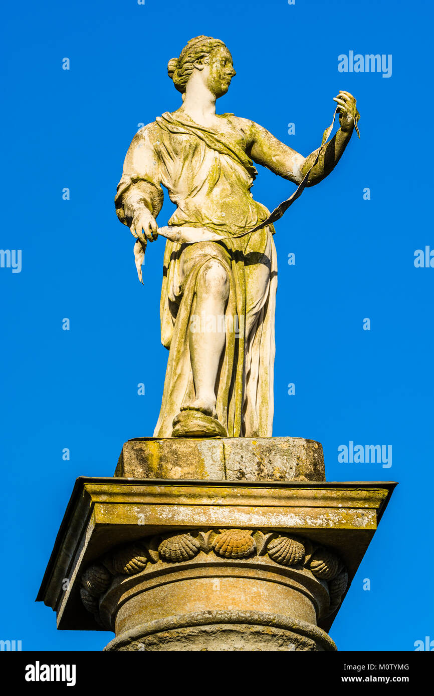 Statue on a pillar at Stowe, Buckinghamshire, UK - Stock Image