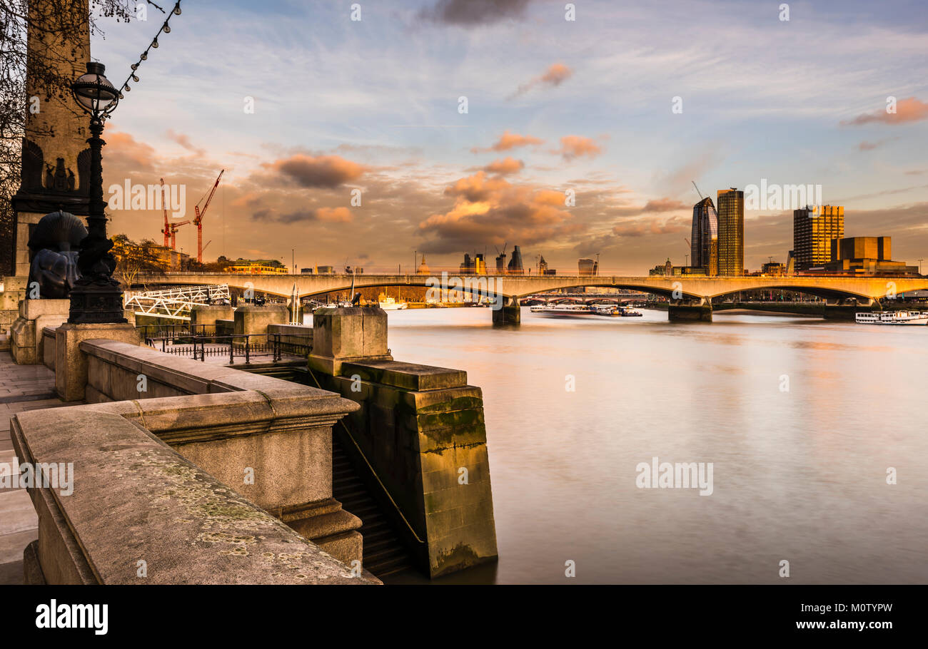 Waterloo Bridge and the City from Embankment at dusk, London, UK - Stock Image