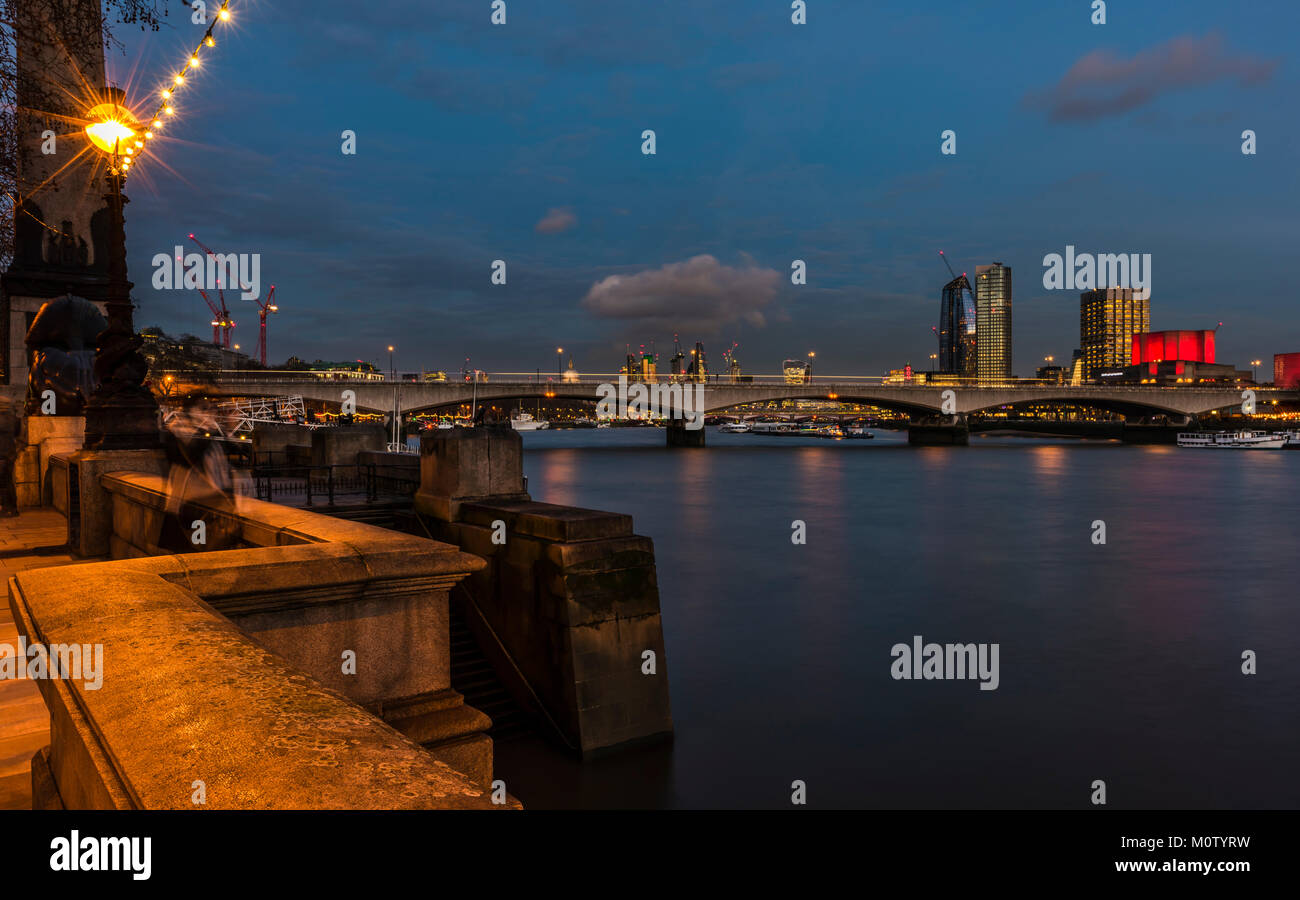 Waterloo Bridge and the City from Embankment at night, London, UK - Stock Image