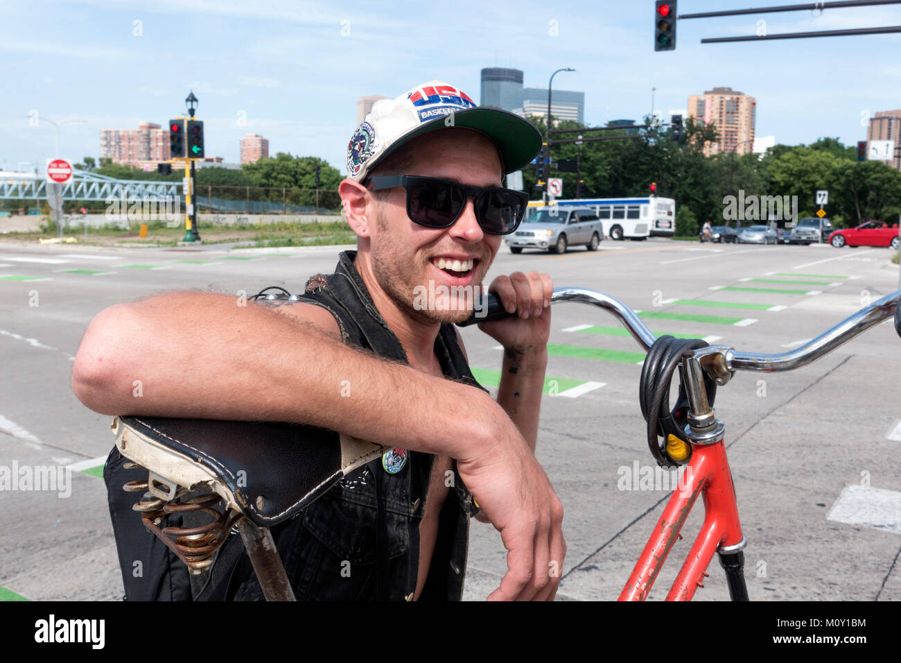 Happy-go-lucky inventor of a double-decker style bicycle Minneapolis Minnesota MN USA - Stock Image