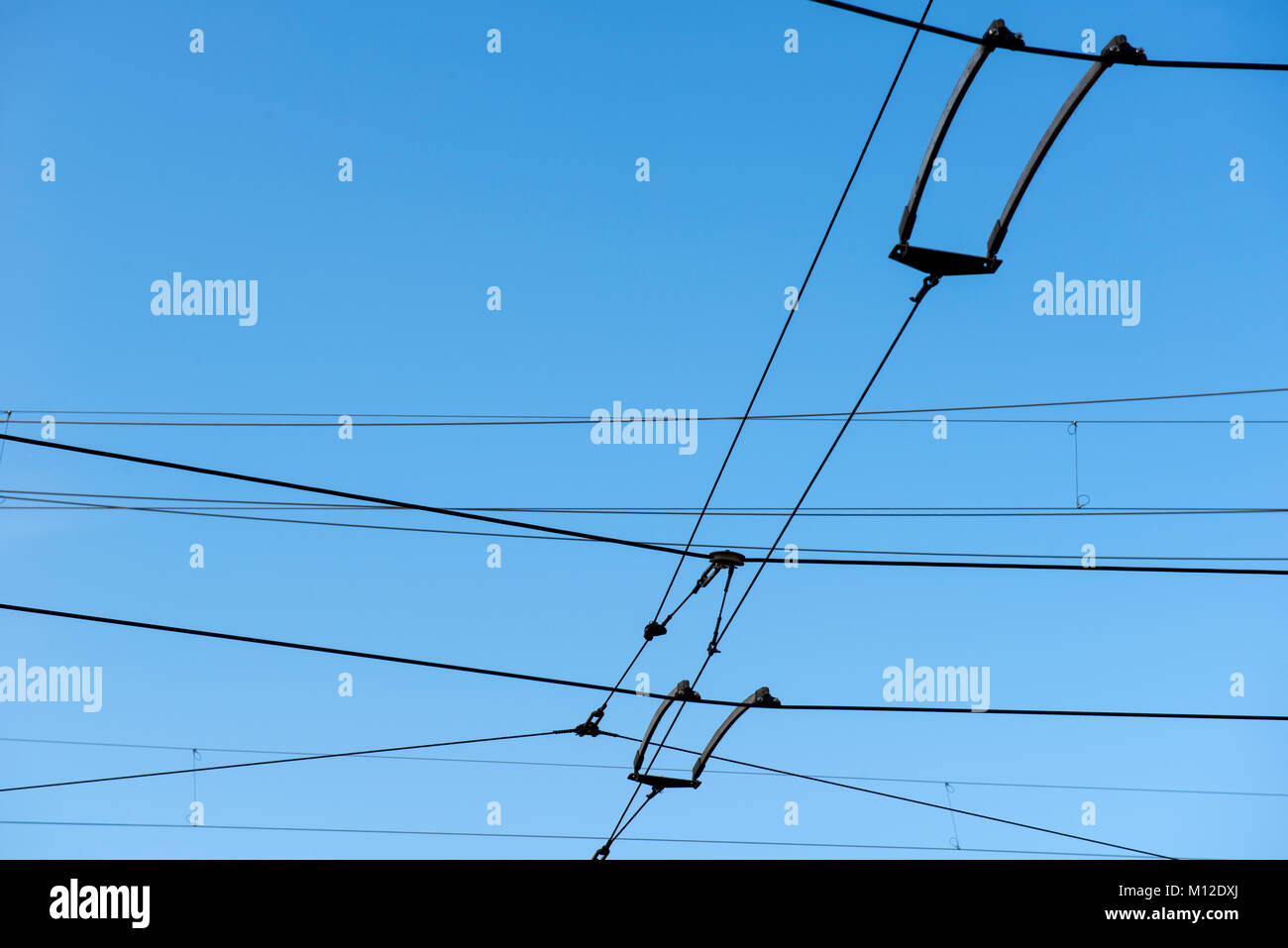 Overhead power lines for a tram system - Stock Image