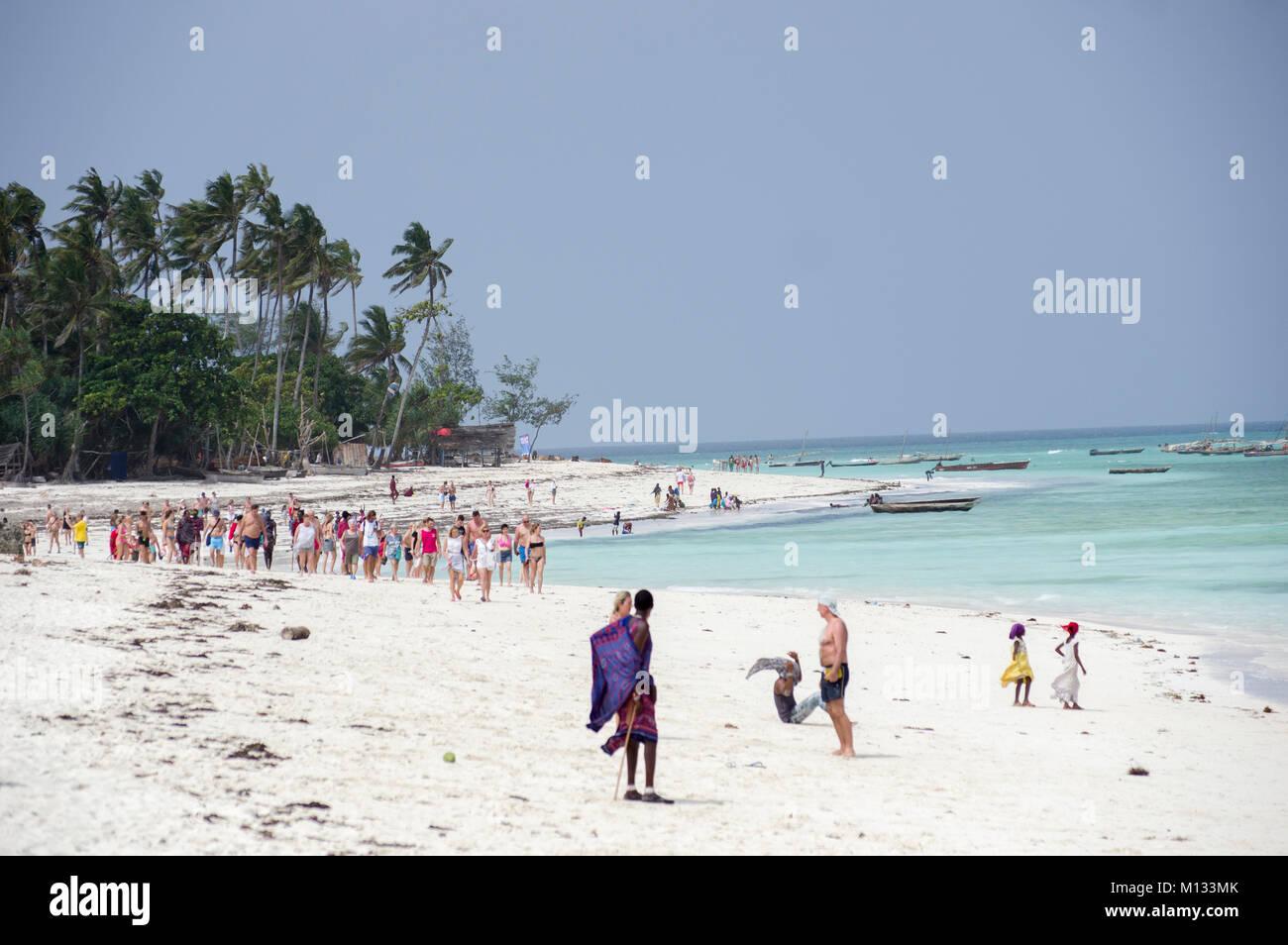 Mobs of Italian tourists descend upon the beach in Nungwi, Zanzibar, Tanzania, to visit the Mnarani Marine Turtles - Stock Image