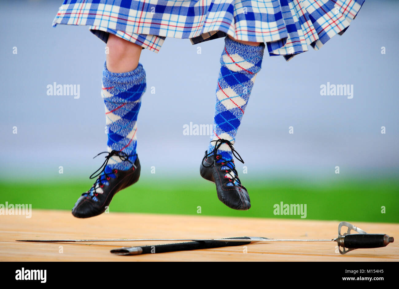 Highland dancers perform at the Ballater Highland Games, Monaltrie Park,  Ballater, Royal Deeside, Aberdeenshire. - Stock Image