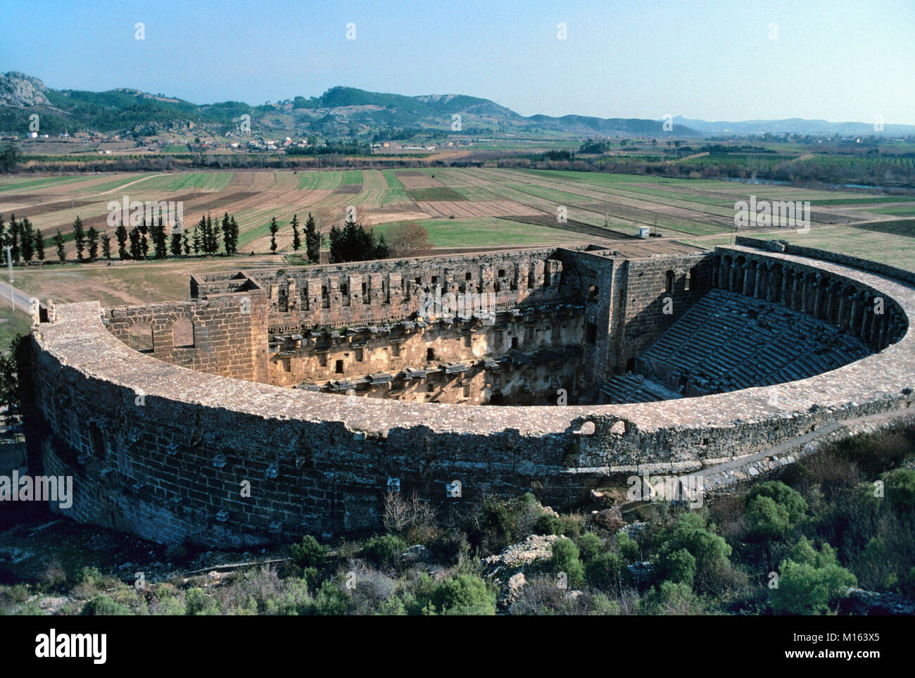 The Roman Theatre (c2nd) at Aspendos, built by the Greek architect Zenon in 155 AD, Antalya, Turkey. The building - Stock Image