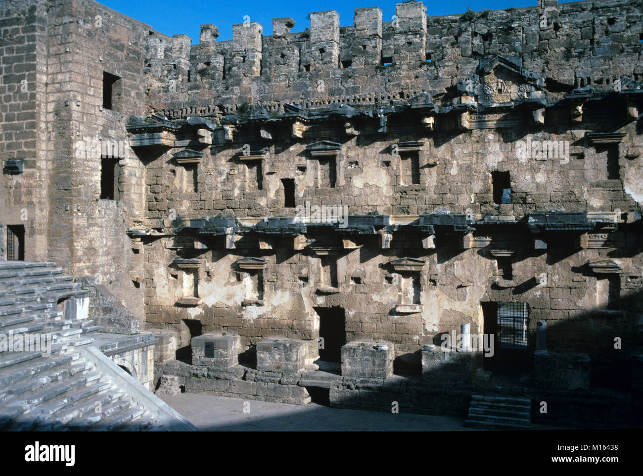 Stage Wall of the Roman Theatre (c2nd) at Aspendos, built by the Greek architect Zenon in 155 AD, Antalya, Turkey. - Stock Image