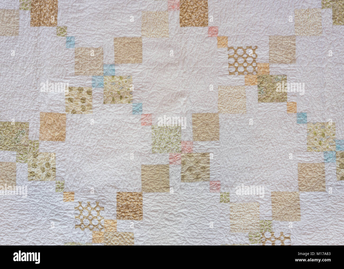 Tan and Neutral Quilt Squares on cream background - Stock Image