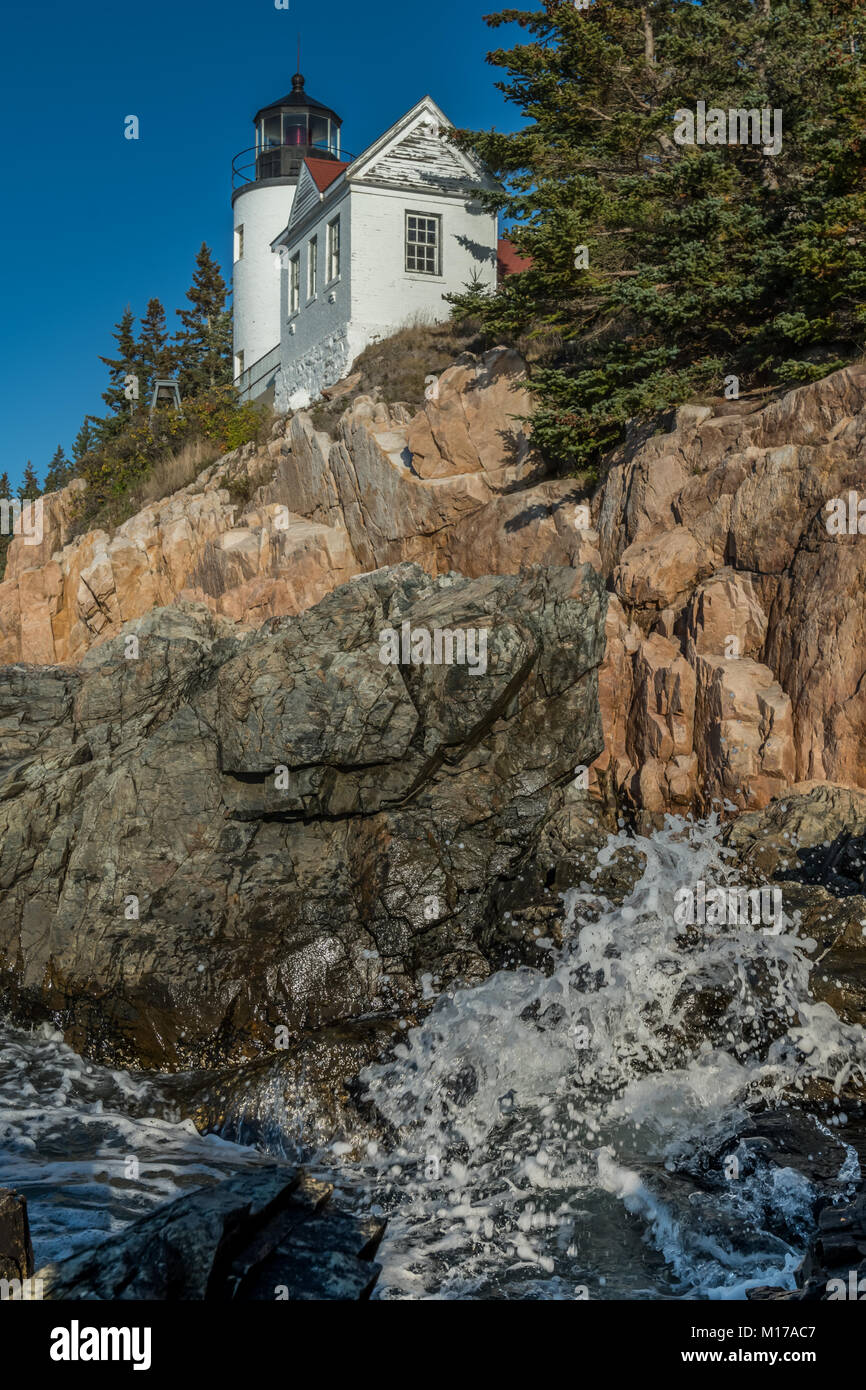 Wave Crashes Below Bass Harbor Lighthouse in Acadia - Stock Image