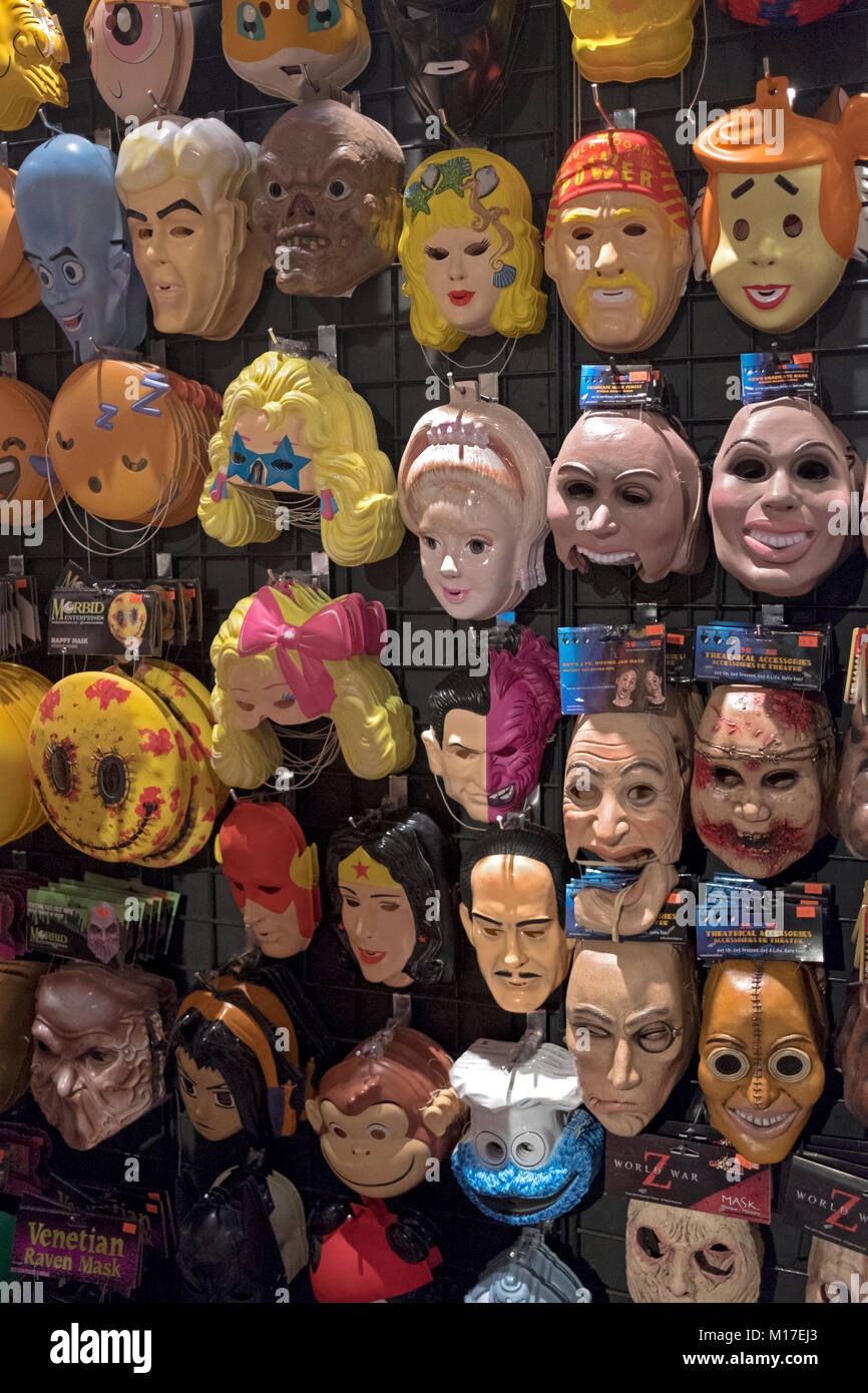 A selection of masks for sale, some looking like celebrities, at a costume shop on Broadway in lower Manhattan, - Stock Image
