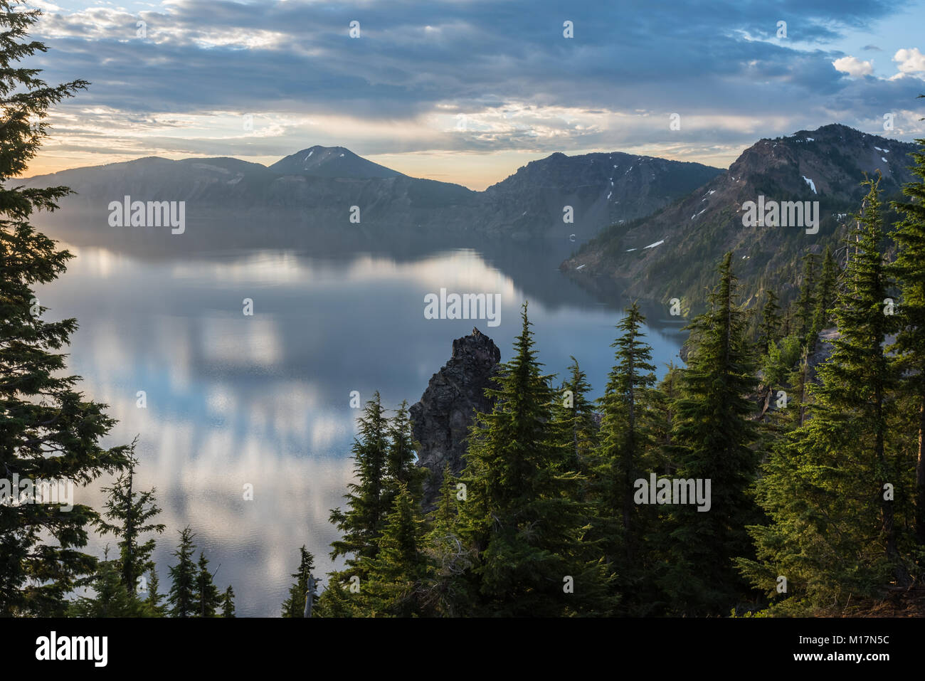 Calm Morning Clouds Reflect in Crater Lake in Oregon - Stock Image