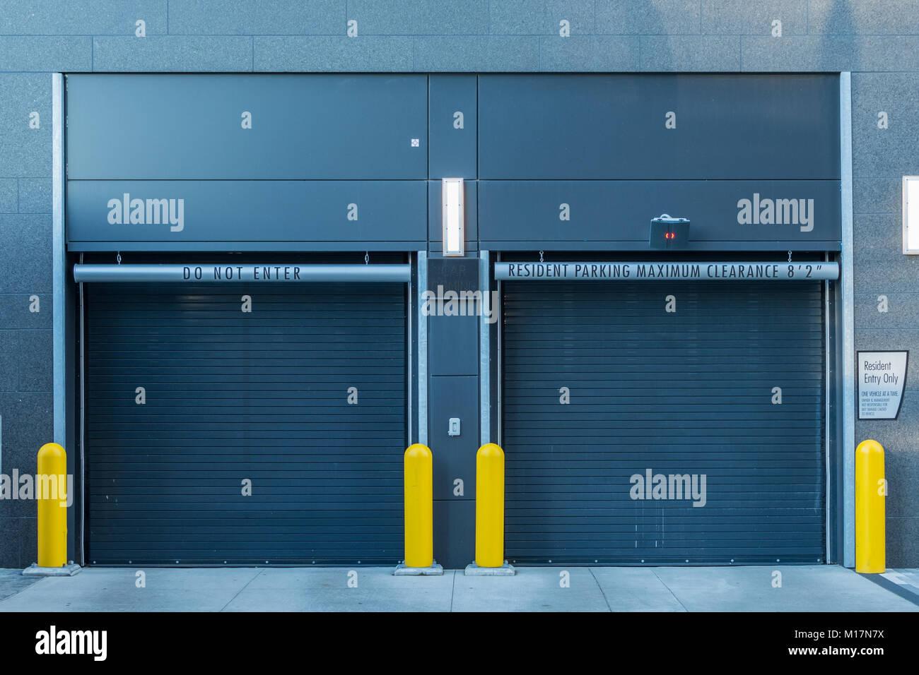 Closed Parking Garage Doors in urban apartment building - Stock Image