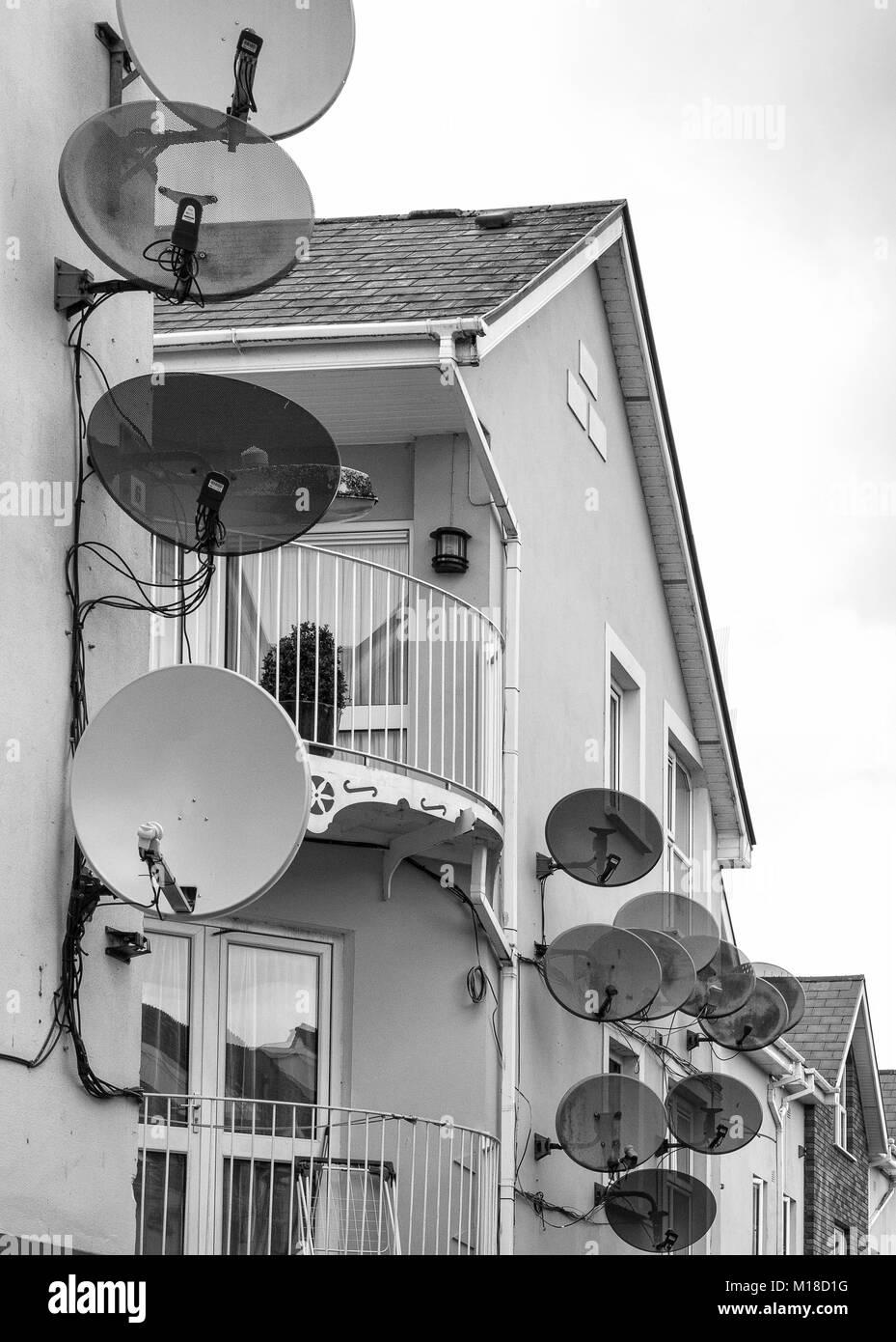 Satellite aerials on apartments - Stock Image
