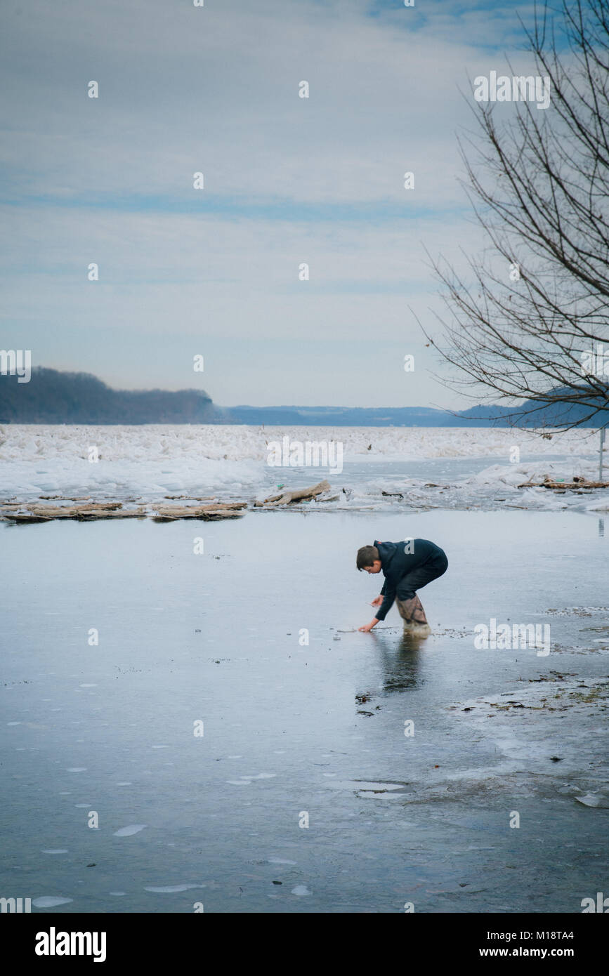 Boy on the frozen Susquehanna  River at Long Level York County PA - Stock Image