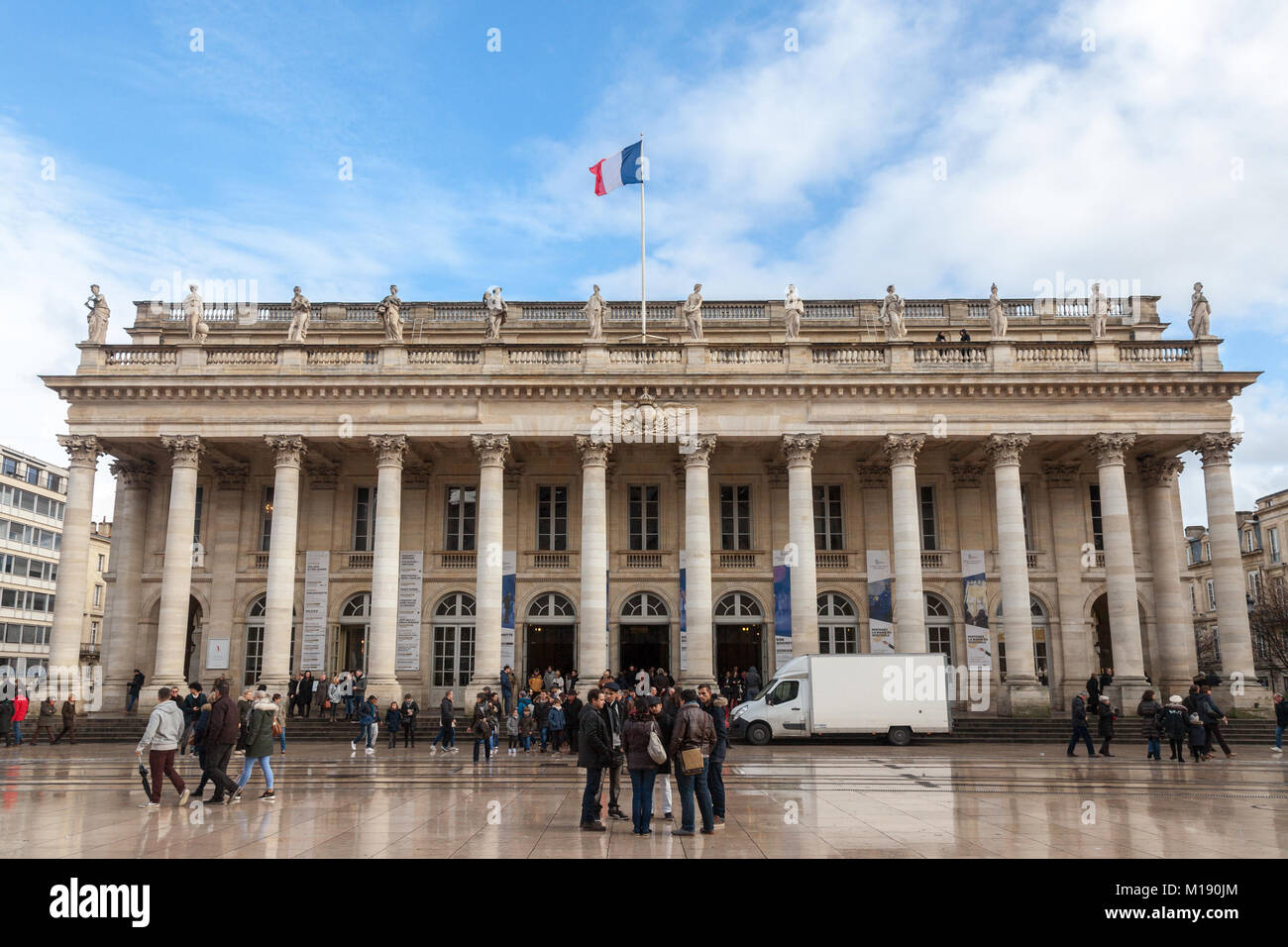 BORDEAUX, FRANCE - DECEMBER 26, 2017: Grand Theatre of Bordeaux taken during a sunny afternoon with a French flag - Stock Image