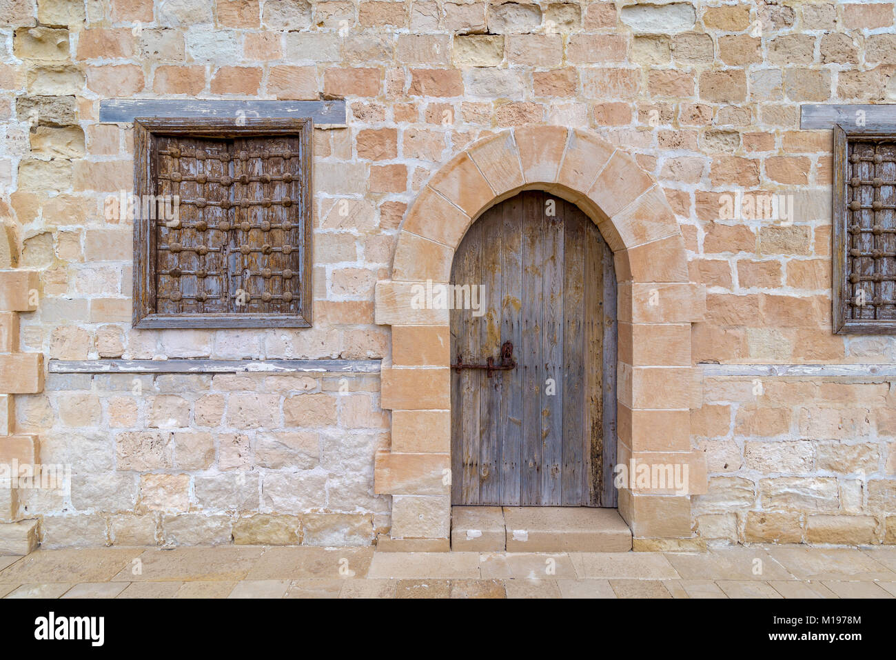 Door and two windows of one of the rooms surrounding the main yard of the citadel of Alexandria, Egypt - Stock Image