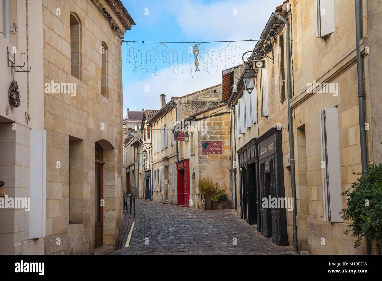 SAINT EMILION, FRANCE - DECEMBER 25, 2017: Main street of the medieval city of Saint Emilion. Wine shops can be - Stock Image