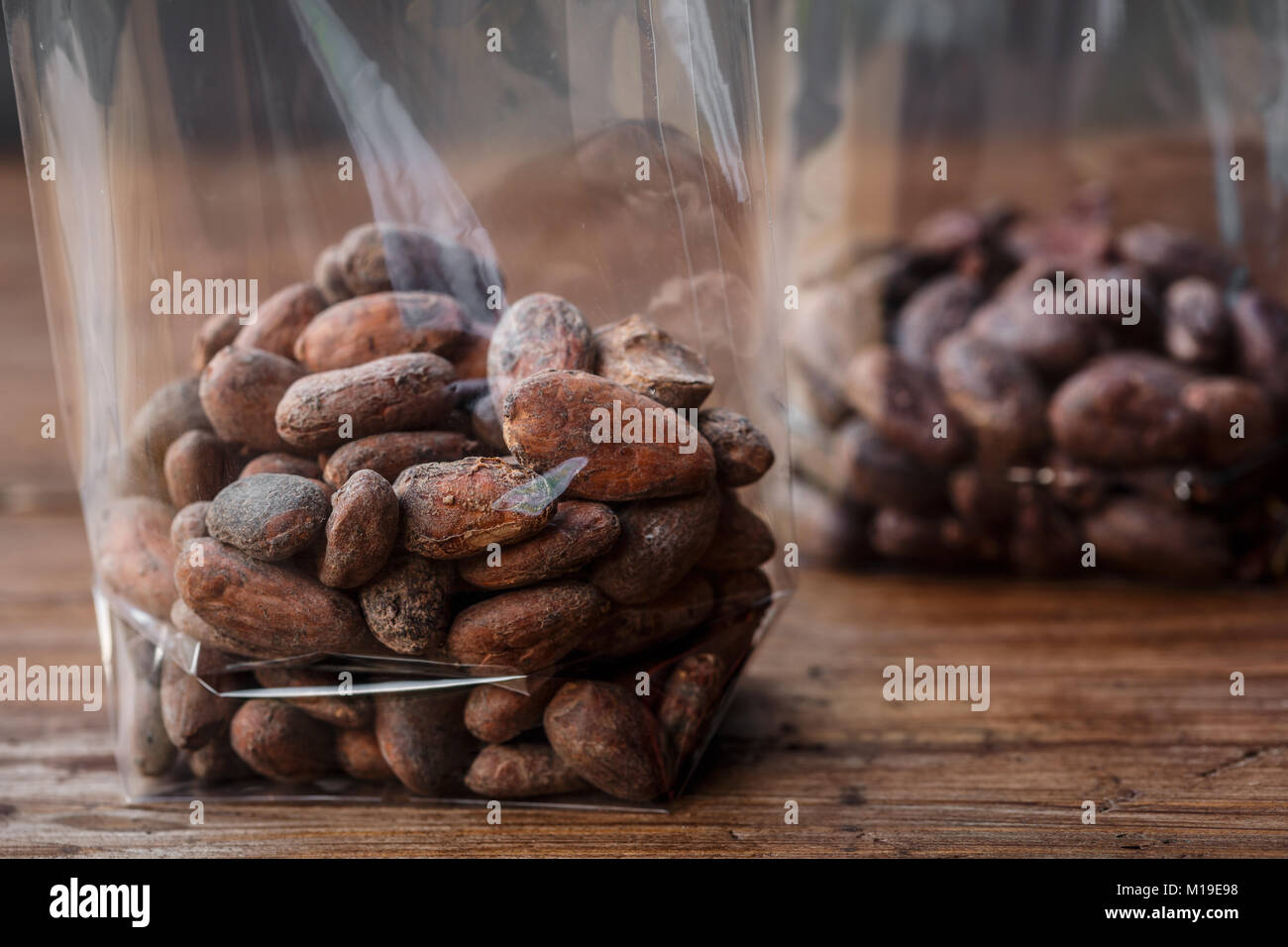 Cocoa beans in plastic bag - Stock Image
