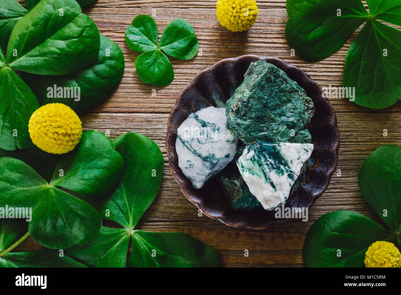 Stones and Elements of St. Patrick's Day, Including Shamrocks, Green Aventurine and Tree Agate. - Stock Image