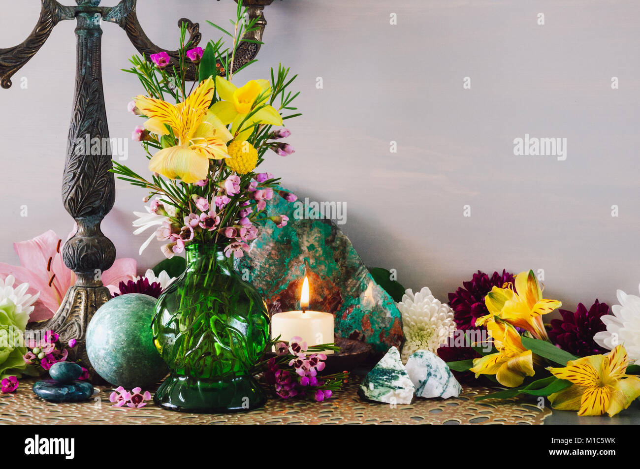 Altar celebrating the Spring Equinox with Assorted Flowers and Stones. - Stock Image