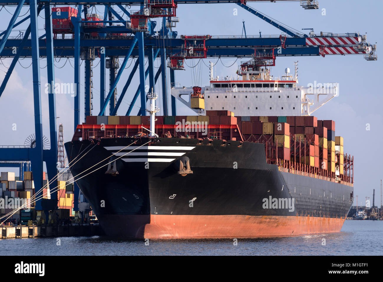 Shipping - Loading a large container ship in the port of Klaipeda in Lithuania. - Stock Image