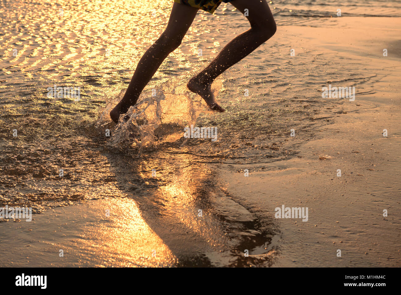 girl boy run on beach stock photos girl boy run on beach stock images alamy. Black Bedroom Furniture Sets. Home Design Ideas
