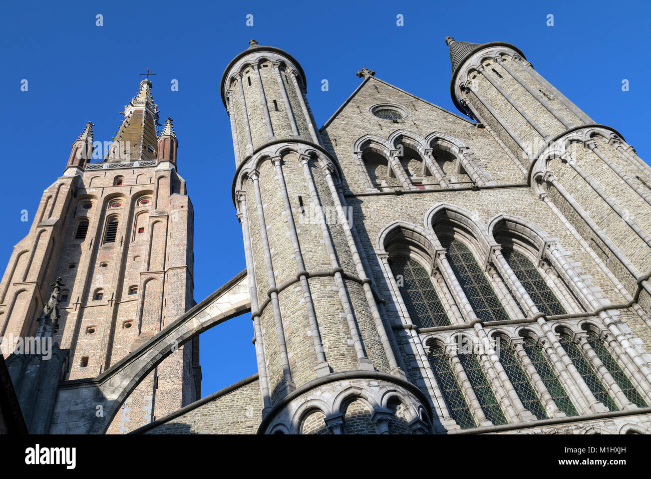 The Gothic architecture of the Roman Catholic Church of Our Lady in the city of Bruges in Belgium. - Stock Image