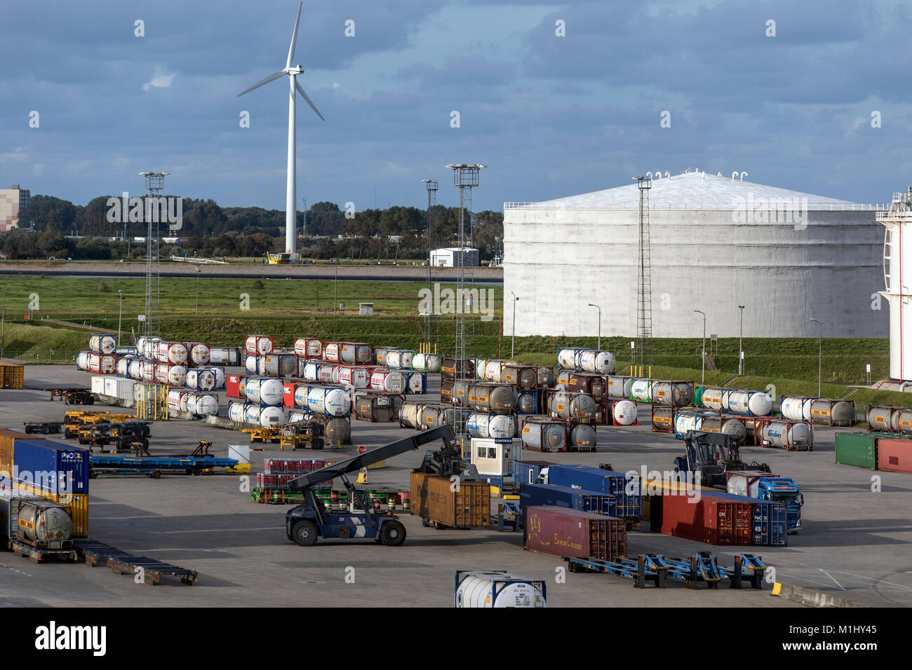 Chemical storage tanks and containers in a storage area in the Port of Rotterdam, Belgium. - Stock Image