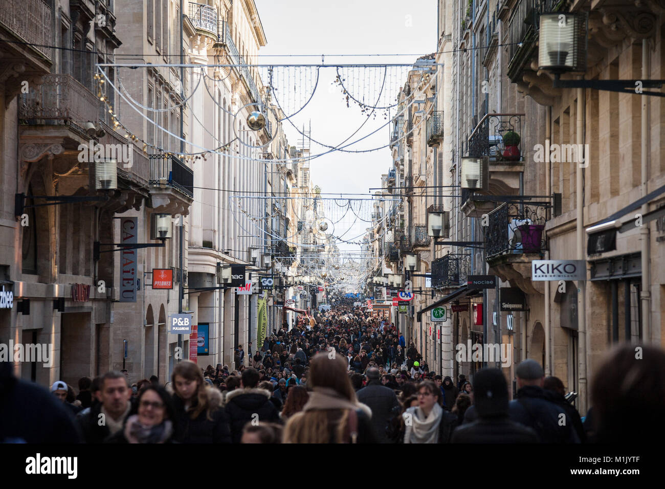 BORDEAUX, FRANCE - DECEMBER 27, 2017: Sainte Catherine street during rush hour crowded with people shopping among - Stock Image