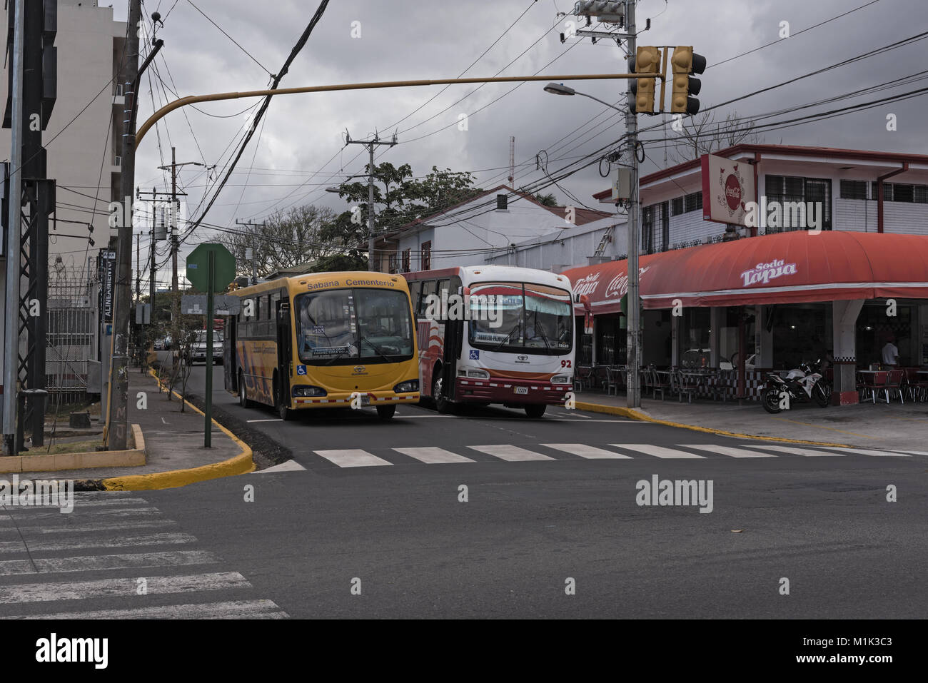 Two buses on a street in San Jose, the capital of Costa Rica - Stock Image