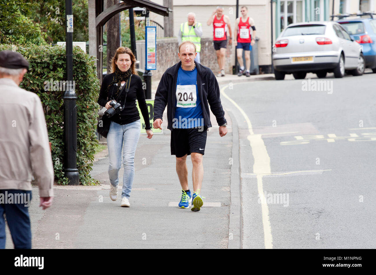 Walking to the start of a road race - Stock Image