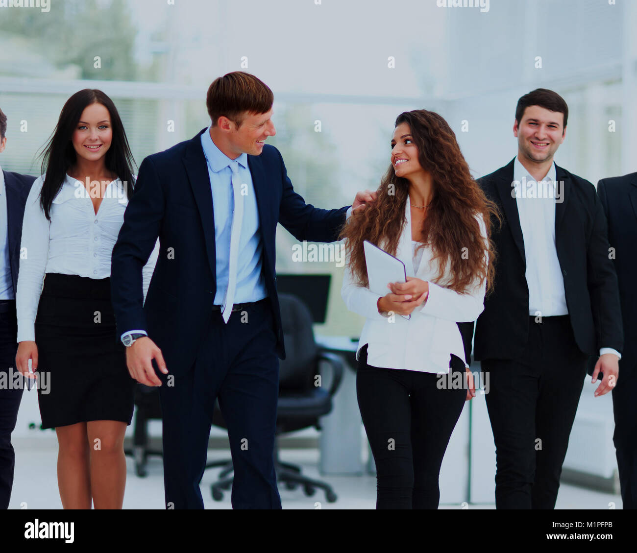 Team cheer up each other in the office. - Stock Image
