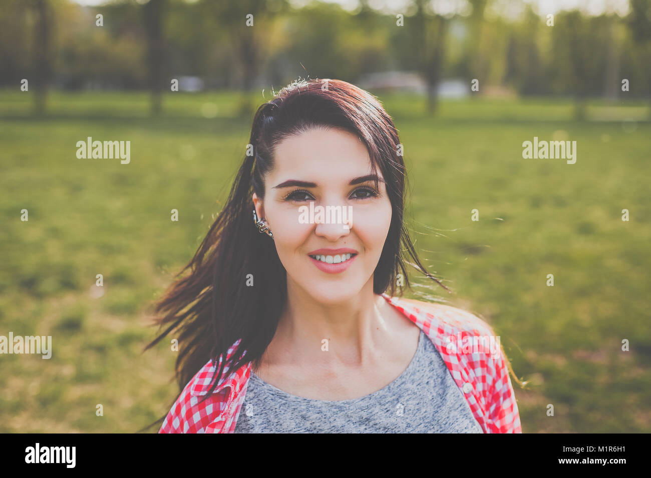 hipster girl smiling - Stock Image