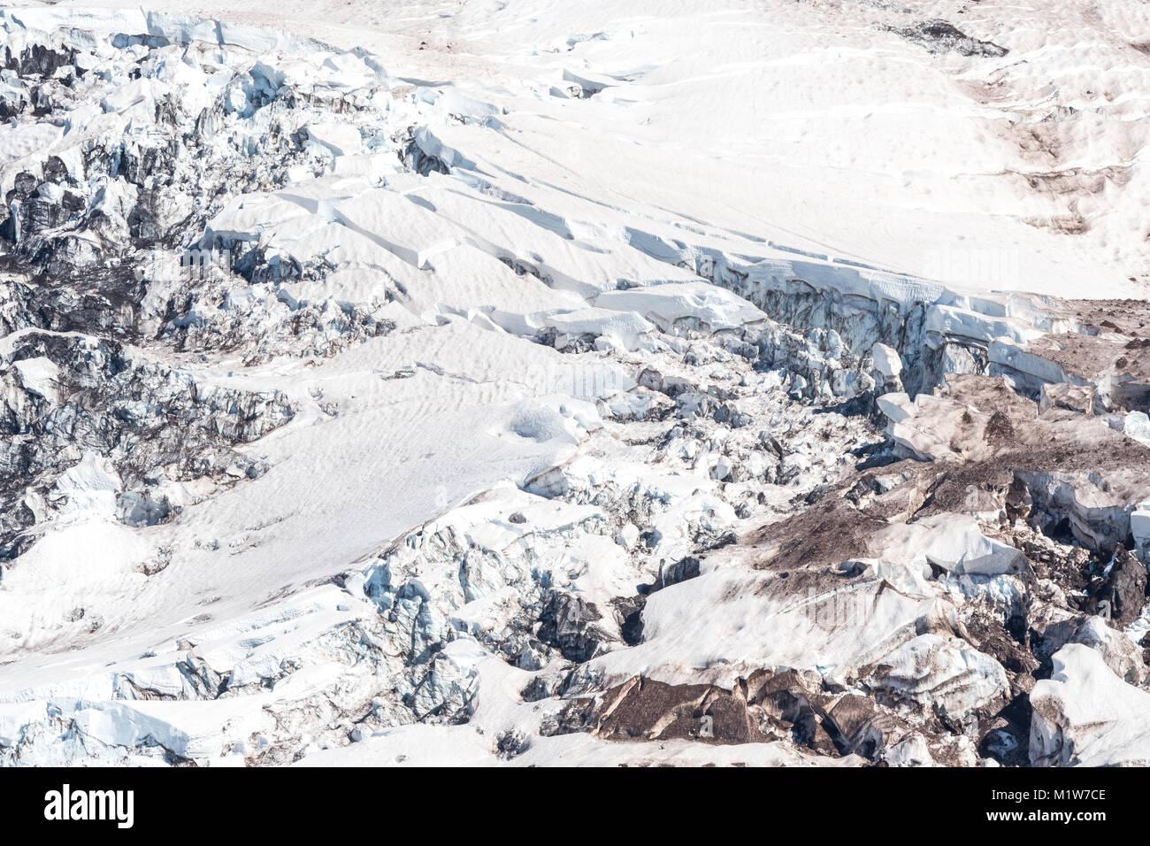 Glacier on Mount Rainier collapsing during summer - Stock Image