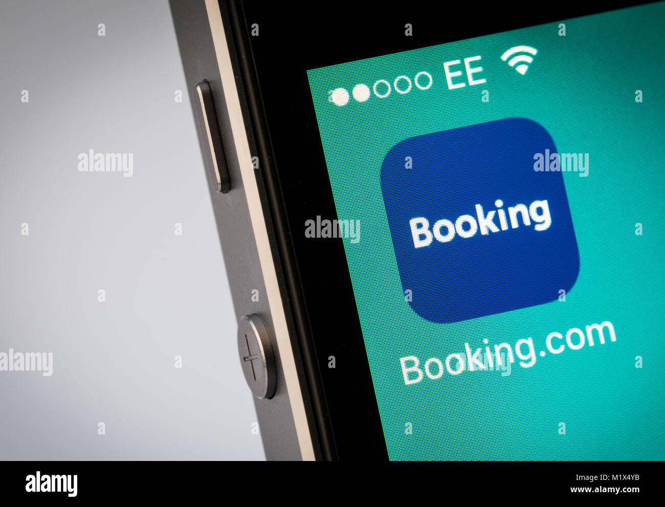 Booking.com app on an iPhone mobile phone - Stock Image