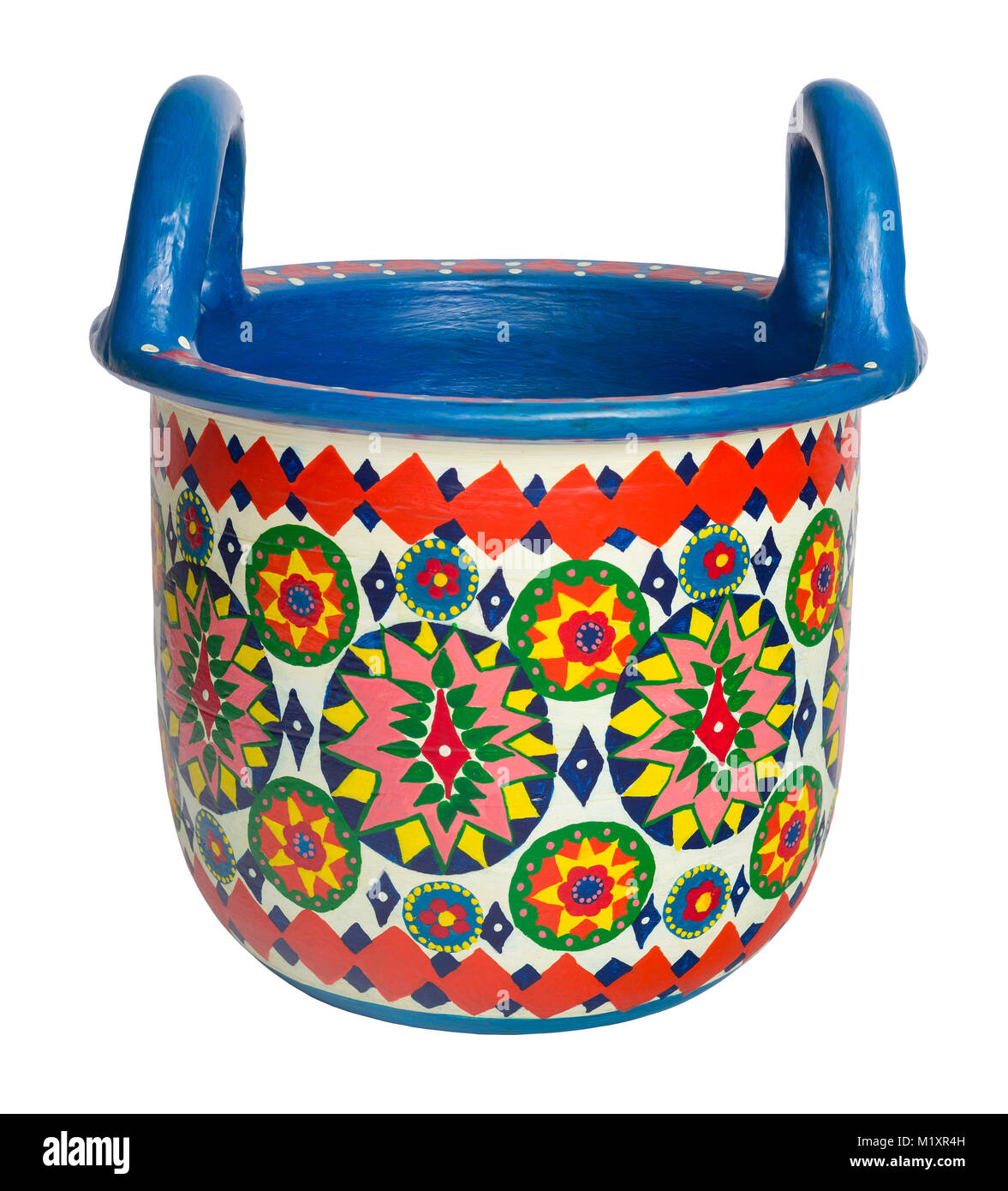 Handmade artistic pained colorful decorated pottery basket with two handles on white background with clipping path - Stock Image