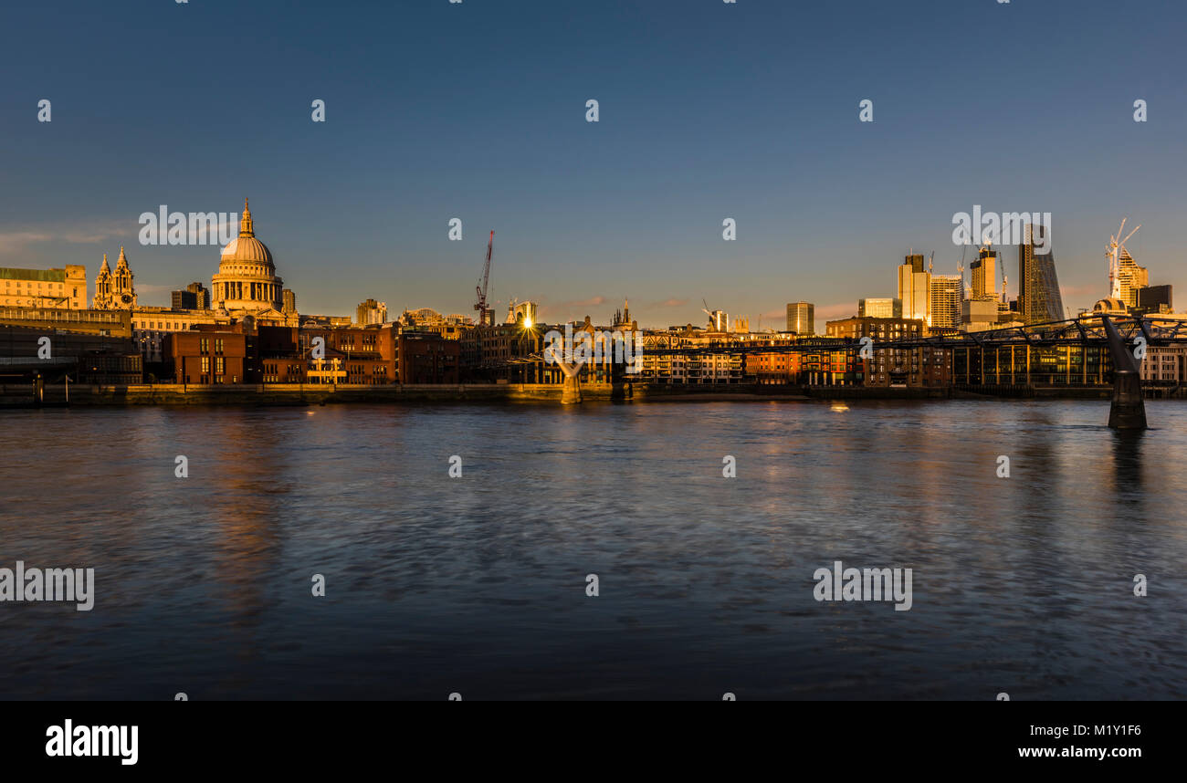 St Paul's Cathedral overlooking the River Thames at sunset, Bankside, London, UK - Stock Image