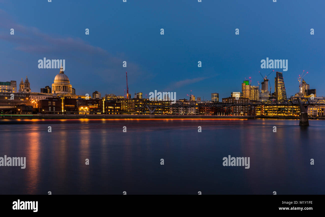 St Paul's Cathedral overlooking the River Thames at dusk, Bankside, London, UK - Stock Image