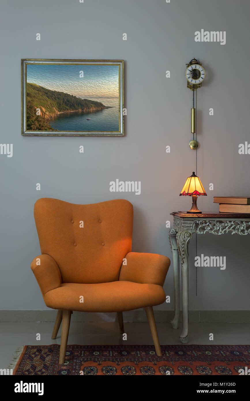 Vintage Furniture - Interior composition of retro orange armchair, vintage wooden beige table, illuminated antique - Stock Image