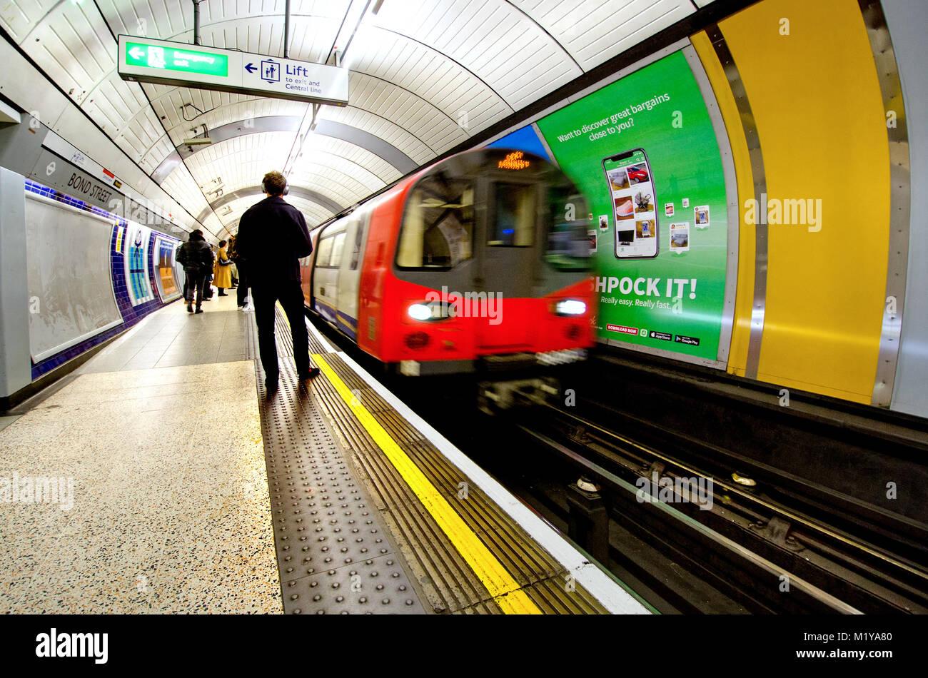 London, England, UK. Tube train arriving in Bond Street underground station - Stock Image