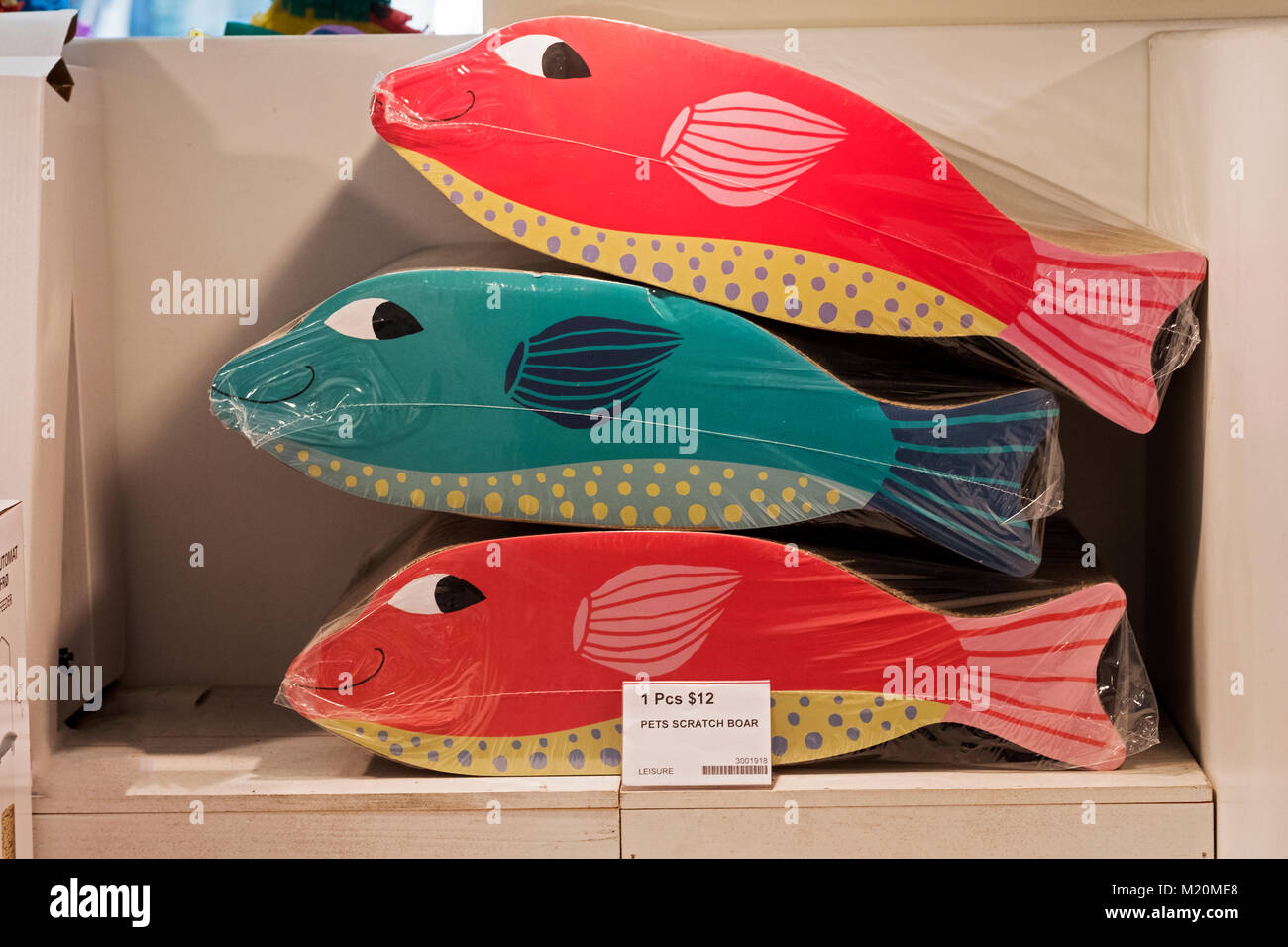 Fish shaped scratch boards for sale at Flying Tiger Copenhagen, a Danish chain store with inexpensive household - Stock Image