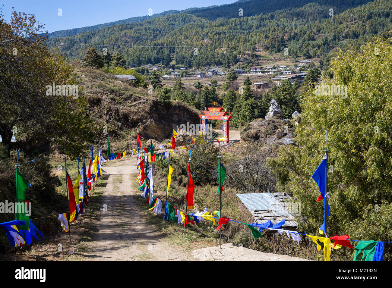 Prakhar Lhakhang, Bumthang, Bhutan.  Pathway Leading to the Monastery, Decorated for the King's Arrival. - Stock Image