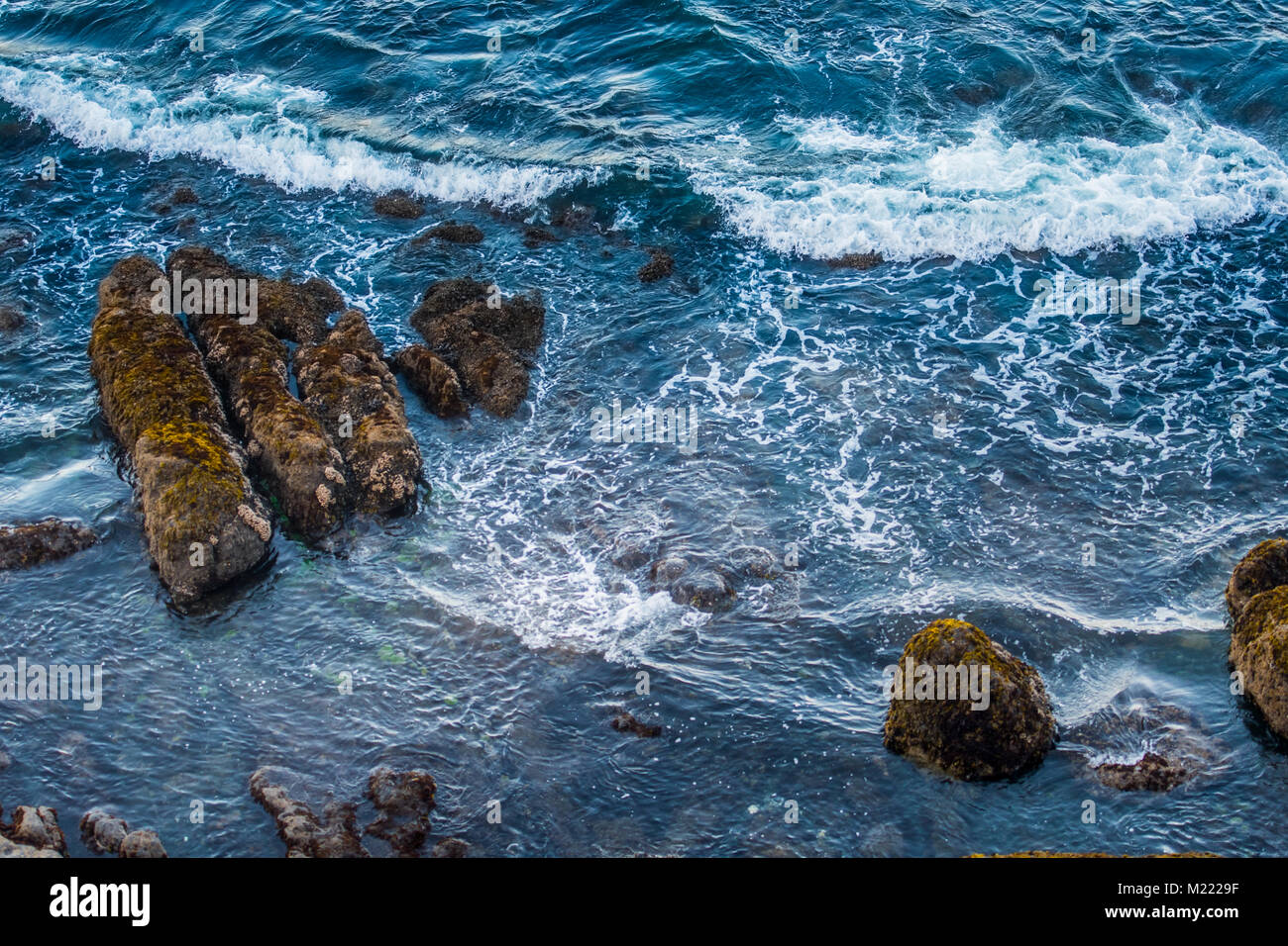 Waves Crash in the Blue Pacific Waters Along the Oregon Coast - Stock Image