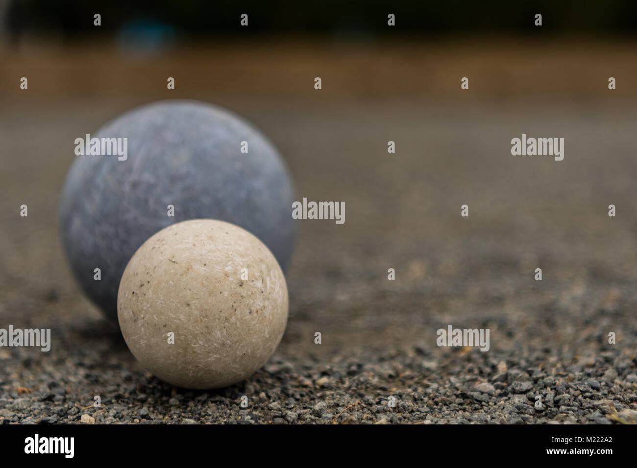 White Bocce Ball with Blue Ball Close Copy Space Right - Stock Image