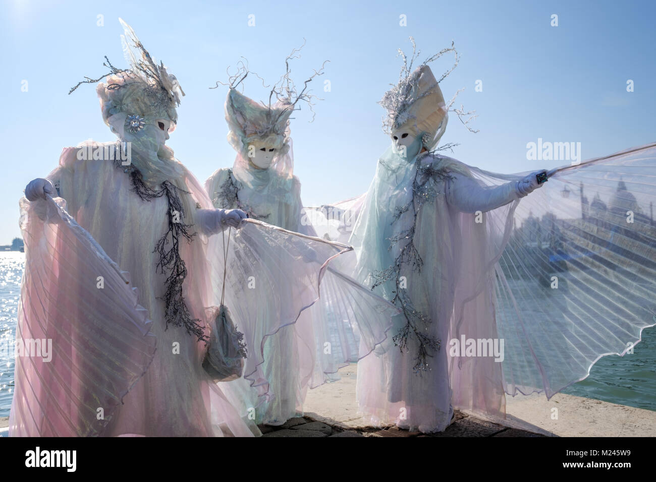 Venice Carnival 2018. After the opening event of the flying angel, Masks posing near Piazza San Marco. Venice, Italy. - Stock Image
