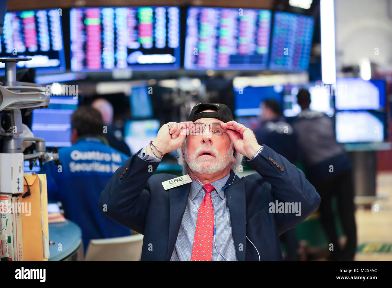 New York, USA. 5th Feb, 2018. A trader works at the New York Stock Exchange in New York, the United States, on Feb. - Stock Image
