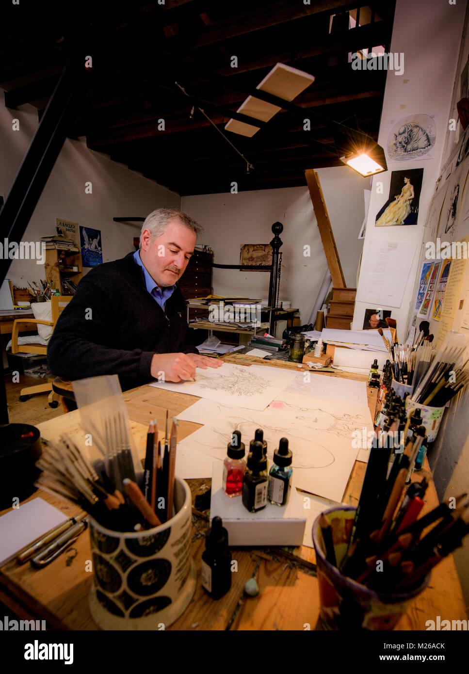 Illustrator and political cartoonist Chris Riddell at his Brighton studio in East Sussex UK. - Stock Image