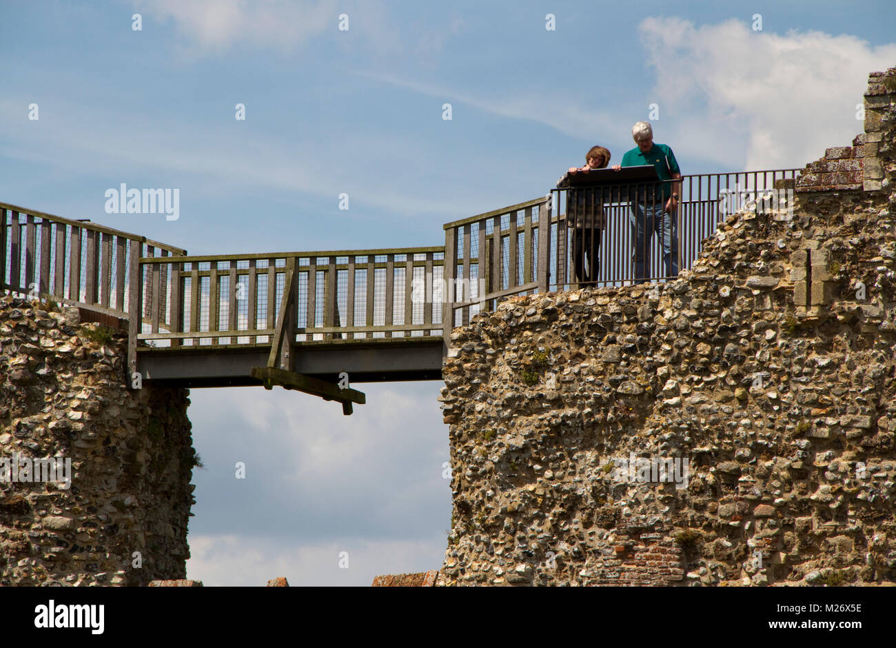 A couple look at an information board on the walls of Framlingham castle - Stock Image