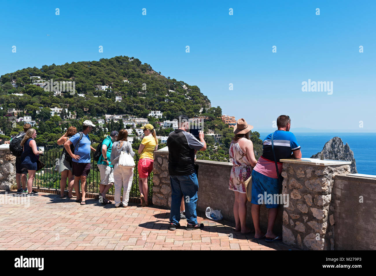 tourists look out over the bay of naples, in the mediterranean sea from augustus gardens on the island of capri, - Stock Image