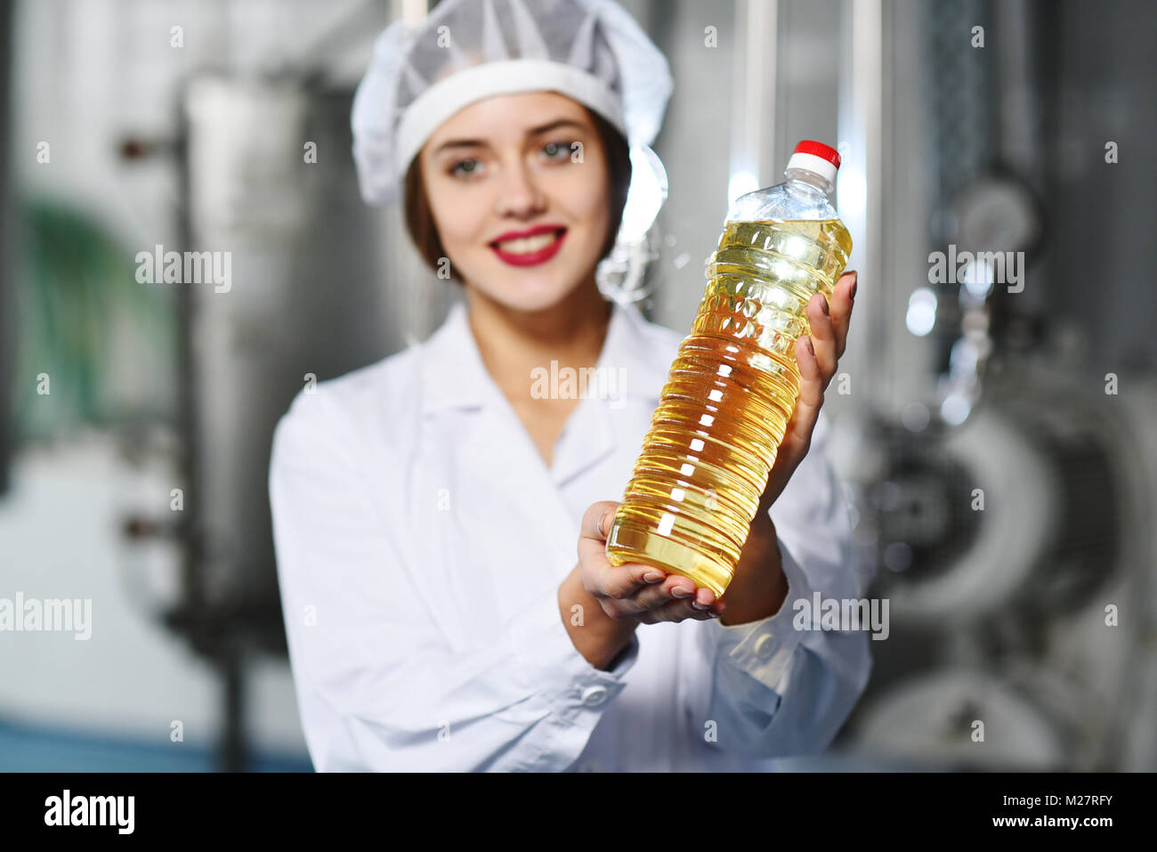 food production line of refined oil. - Stock Image