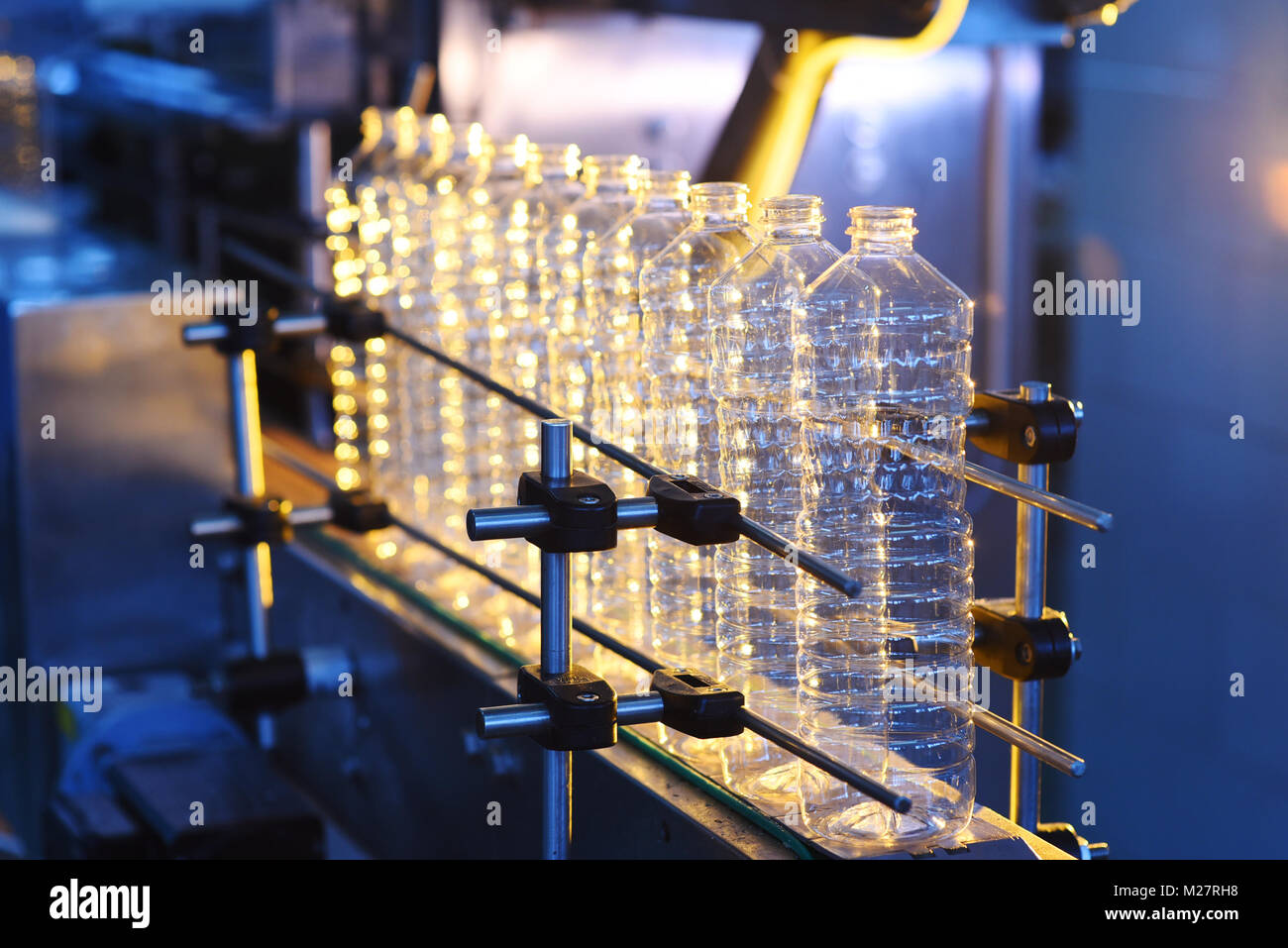 conveyor line for the production of plastic bottles - Stock Image