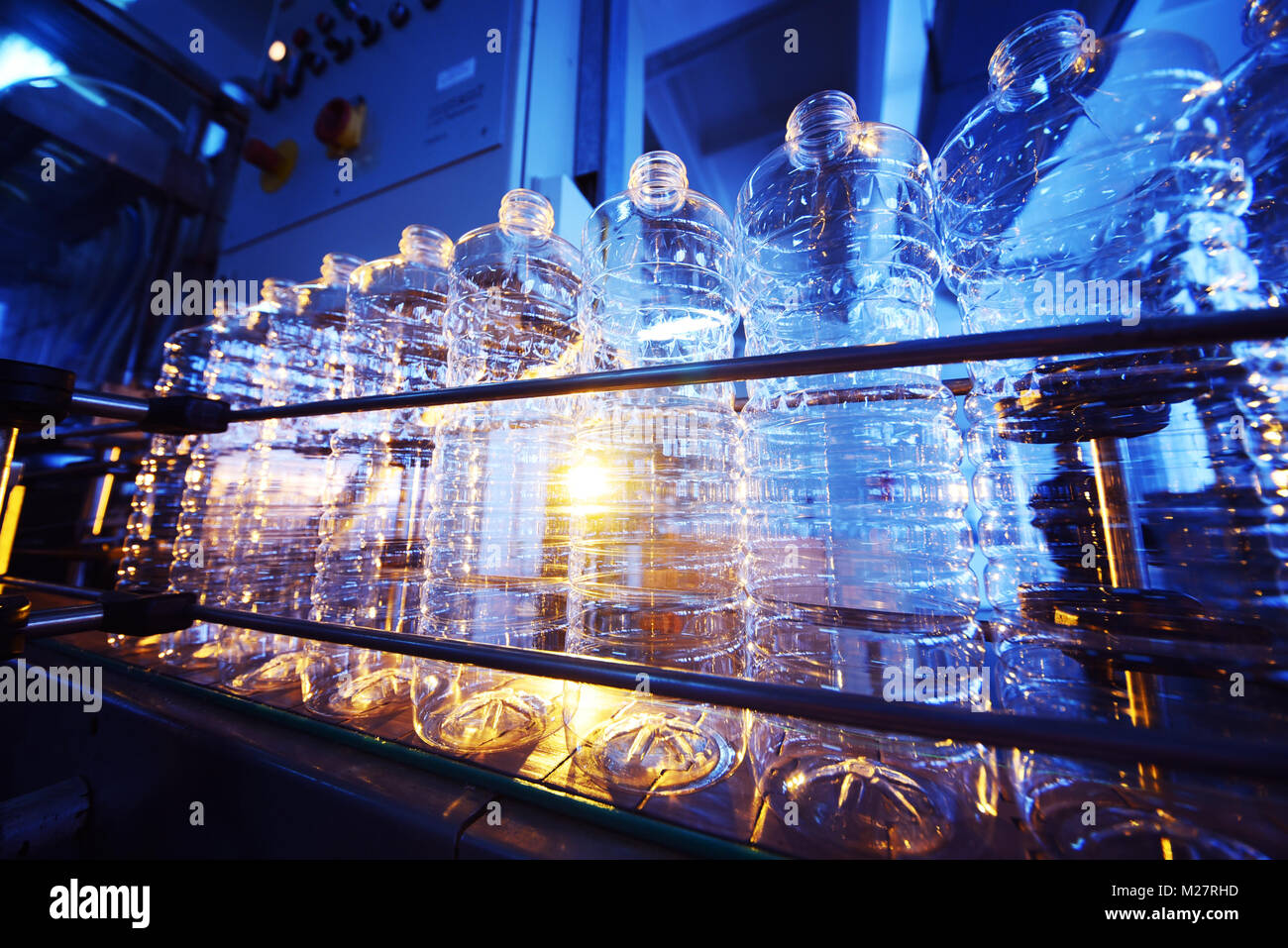 Line for the production of plastic PET bottles - Stock Image